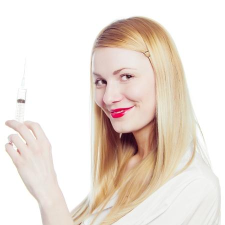 pretty nurse with syringe photo