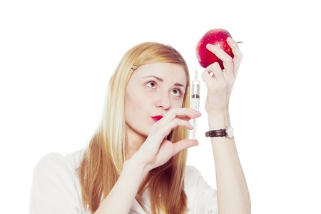 woman doctor with syringe and apple  photo