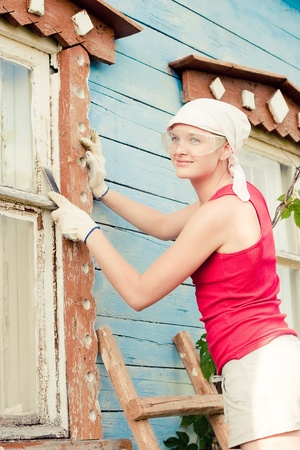 Portrait of smiling young woman making cosmetic alterations of house photo