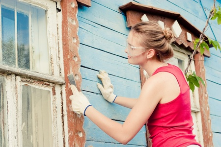 Portrait of smiling young woman making cosmetic alterations of house Stock Photo - 10734116