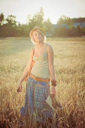 Image of young woman on wheat field  photo