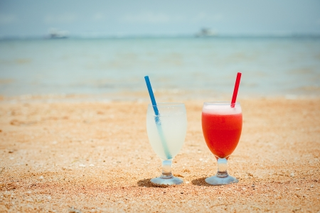 Pair of fruit shakes on the tropical beach Stock Photo - 16655353