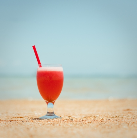 fruit shake on the tropical beach photo