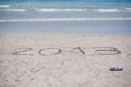 New year background of beach with  2013  drawn in the sand  photo