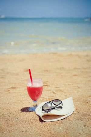 Bocal of fruity cocktail on a beach Stock Photo - 17395918