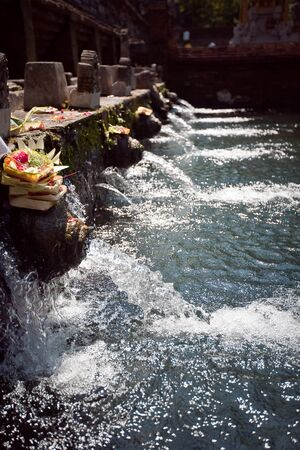 holy spring water in tirta empul, bali, indonesia photo