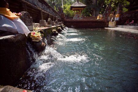 holy spring water in tirta empul, bali, indonesia