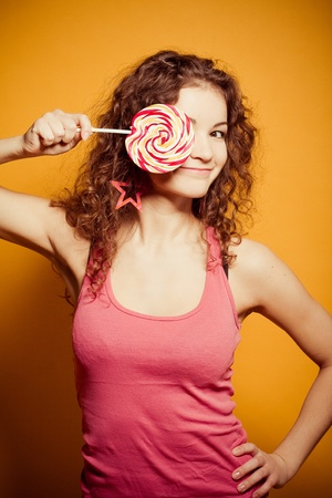 happy young woman with lollipop photo