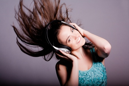 Girl With Headphones Singing and Dancing  On White Background photo
