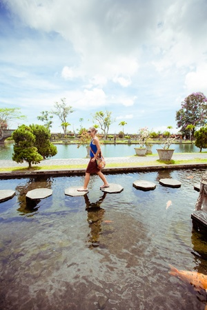 Woman in Tirtagangga water palace on Bali island, Indonesia