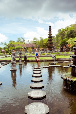 Woman in Tirtagangga water palace on Bali island, Indonesia photo