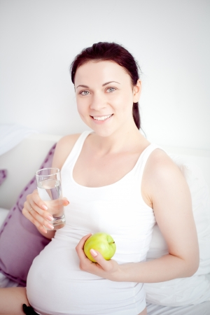 young pregnant woman in the bedroom Stock Photo - 21612000