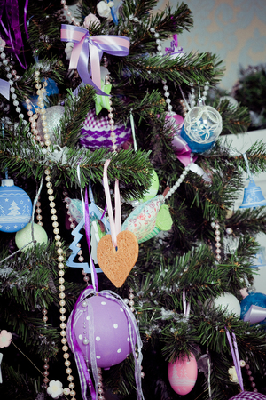 Beautiful traditional christmas decorations on an xmas tree Stock Photo - 22513778