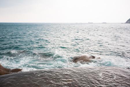 koh tao: Waves crashing on rocks at coast in Thailand, Koh Tao Stock Photo