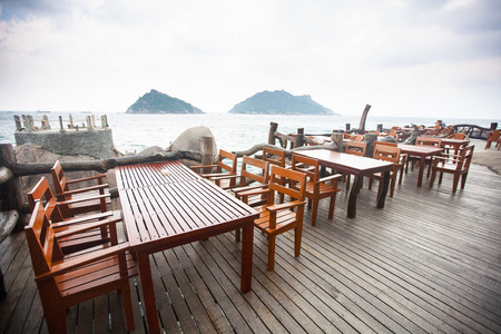 Restaurant on the coast, view of the waves crashing in Thailand, Koh Tao photo
