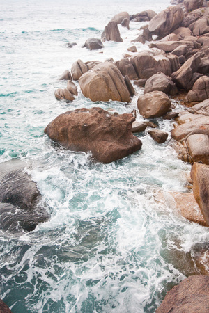 Waves crashing on rocks at coast in Thailand, Koh Tao photo