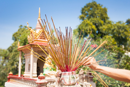 Offerings to gods in  temple with aroma sticks in Cambodia photo
