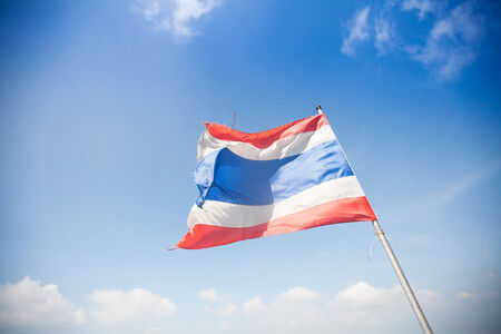 National flag of Thailand on sky background photo