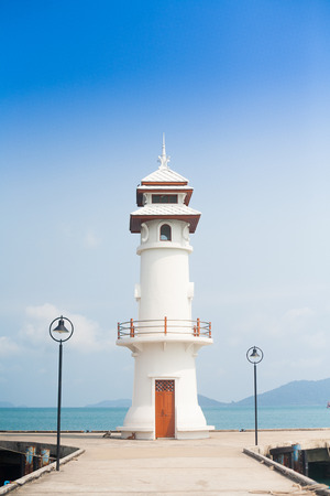 Lighthouse at the sea pier on Ko Chang island, Thailand photo