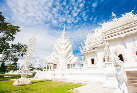 Famous Thailand temple or grand white church Call Wat Rong Khun, at Chiang Rai province, northern Thailand photo