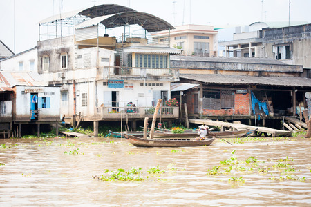 JAN 28 2014 - MY THO, VIETNAM - Houses by a river, on JAN  28, 2014, in  Mekong Delta, Vietnam