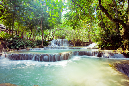 Kuangsi  waterfall in deep forest in Luang Prabang, Laos photo