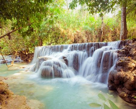 Kuangsi  waterfall in deep forest in Luang Prabang, Laos photo