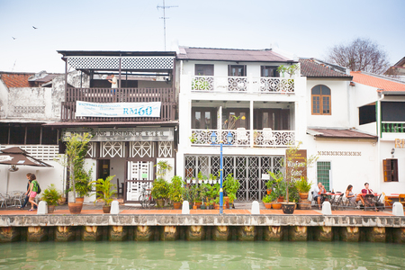 dwell: Malacca city with house near river under blue sky, Malaysia
