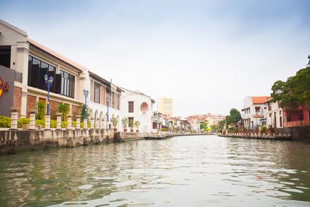 dwell house: Malacca city with house near river under blue sky, Malaysia