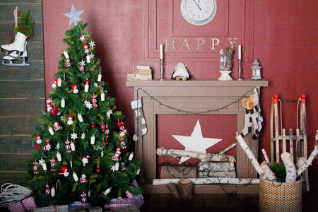 Decorated Christmas tree in red and white colors photo