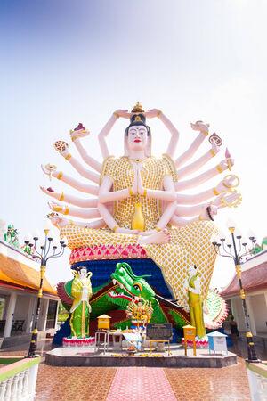 18 hands God statue on blue sky in Koh Samui, Thailand photo