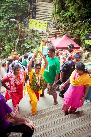 BATU CAVES, MALAYSIA - JAN 18 2014 : Thaipusam at Batu Caves temple, Malaysia on January 18, 2014. Thaipusam is a Hindu festival on the full moon in the Tamil month of Thai.