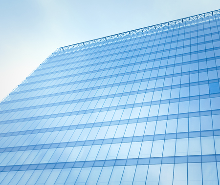 reflecting sky in glass of office building ; abstract background photo