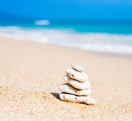Stack of round stones on a seashore photo