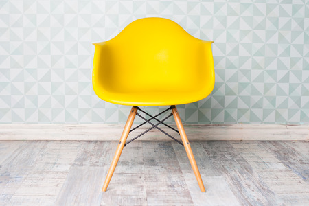 old office: modern yellow chair in room Stock Photo