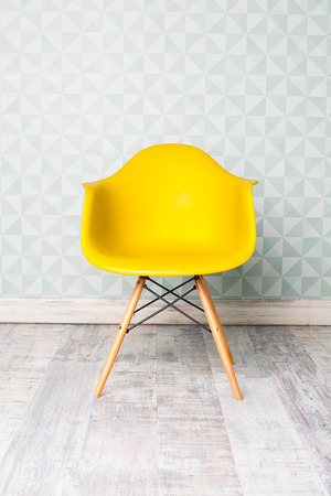 modern yellow chair in room Standard-Bild