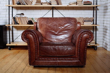 living wisdom: Classic Brown leather armchair in  library room