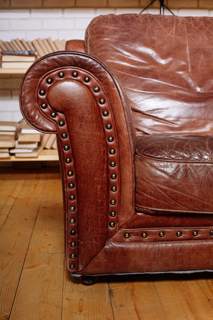 Classic Brown leather armchair in  library room