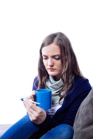 feeble: Young woman having flu against white background Stock Photo