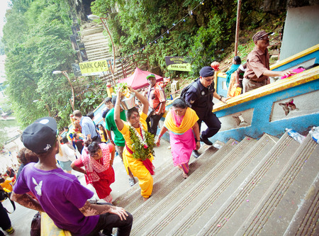 worshipper: BATU CAVES, MALAYSIA - JAN 18 2014 : Thaipusam at Batu Caves temple, Malaysia on January 18, 2014. Thaipusam is a Hindu festival on the full moon in the Tamil month of Thai.