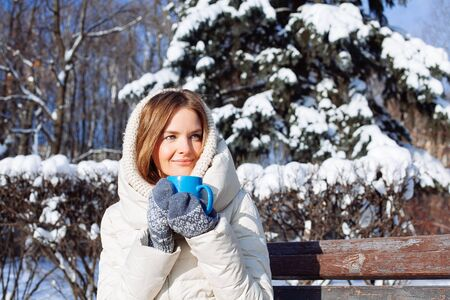 hot drinks: Beautiful Happy Smiling Winter Woman with Blue Mug Outdoor
