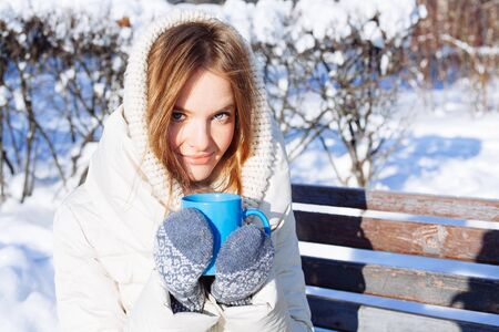 healthy girl: Beautiful Happy Smiling Winter Woman with Blue Mug Outdoor