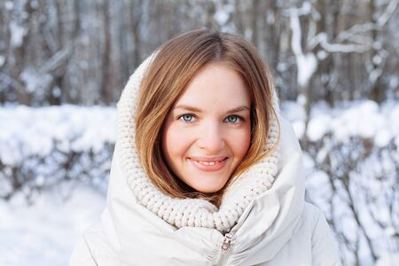 attractive female: Beautiful winter portrait of young woman in the winter snowy scenery