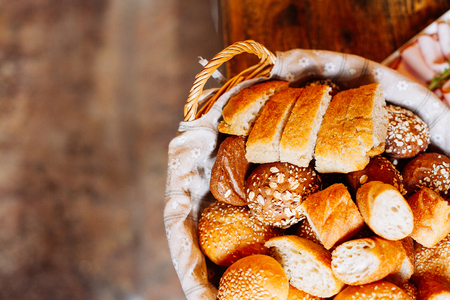 artisanal: Bread in basket,  homemade cooking made from whole wheat and grains Stock Photo