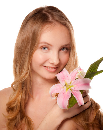 Beautiful young woman with lily photo