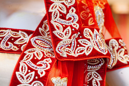 Close up texture of fashion indian sari with crystals, rhinestones and embroidery Standard-Bild