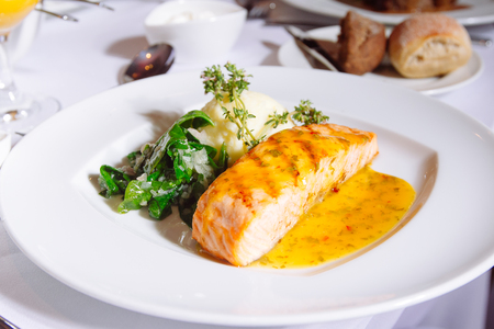 Grilled Salmon Steak with Spinach,Mash potato and souse Stock Photo