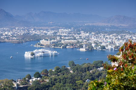 City Palace and Pichola lake in Udaipur, Rajasthan, India, Asia Stock Photo - 77490139
