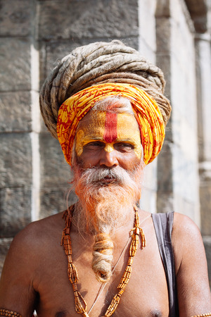 KATHMANDU - FEBRUARY 17: Sadhu at Pashupatinath Temple in Kathmandu, Nepal on Feb 17, 2017. Sadhus are holy men who have chosen to live an ascetic life and focus on the spiritual practice of Hinduism