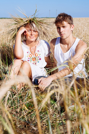Image of young man and woman on wheat field. Summer day Stock Photo